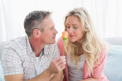Couple relaxing on the couch with girl smelling flower Stock Image