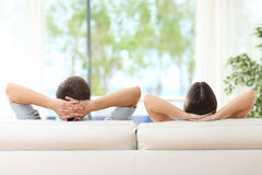 Couple relaxing on a couch at home Royalty Free Stock Photography
