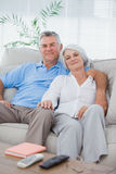 Couple relaxing on a couch Royalty Free Stock Photography
