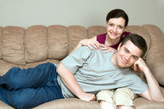 Couple Relaxing on the Couch Together - Horizontal Royalty Free Stock Images
