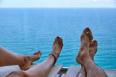 Couple relaxing on a deck chair stock photo