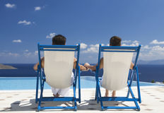 A couple relaxing in deck chairs Royalty Free Stock Photography