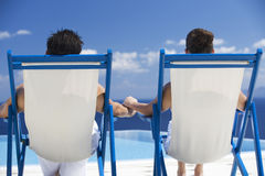 A couple relaxing in deck chairs Stock Photography