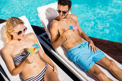 Couple relaxing on deckchairs Stock Image