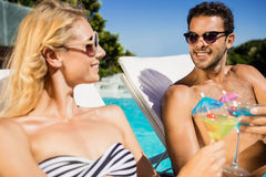Couple relaxing on deckchairs Royalty Free Stock Image