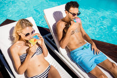 Couple relaxing on deckchairs Stock Photo