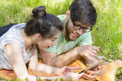 Couple Relaxing with Digital Tablet Stock Photography