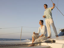 A couple relaxing with a drink on a boat royalty free stock images