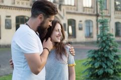 Couple relaxing enjoying each other. Hipster and pretty woman in love stand in street architecture building background. Couple relaxing enjoying each other stock photo