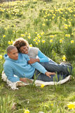 Couple Relaxing In Field Of Spring Daffodils Stock Image