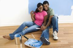 Couple relaxing on floor. Stock Photo
