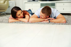 Couple relaxing on the floor at home Stock Image