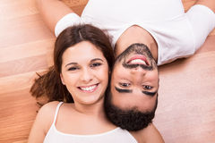 Couple relaxing on the floor Stock Photo