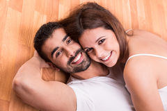 Couple relaxing on the floor Stock Image