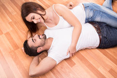 Couple relaxing on the floor Royalty Free Stock Photo