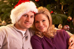 Couple Relaxing In Front Of Christmas Tree Royalty Free Stock Photos