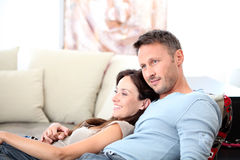 Couple relaxing in front of tv Royalty Free Stock Photo