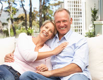 Couple Relaxing In Garden Royalty Free Stock Photos