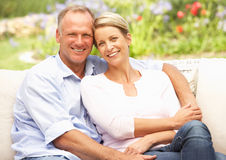 Couple Relaxing In Garden Royalty Free Stock Photography