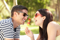 Couple Relaxing In Garden Eating Lolly Royalty Free Stock Images