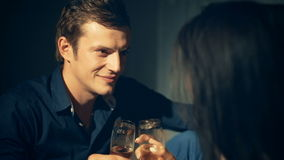 Couple relaxing with glass of wine at romantic fireplace on winter evening stock footage