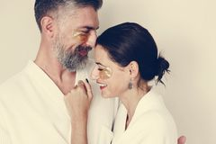 Couple relaxing with golden eye mask treatment stock image