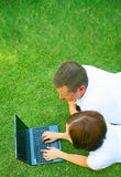 Couple Relaxing On Grass Royalty Free Stock Photos