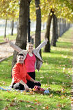 Couple Relaxing on the Grass and Eating Apples Stock Image