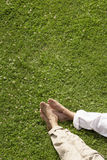 Couple Relaxing On Grass Royalty Free Stock Photo