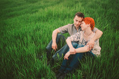 Couple Relaxing on Green Grass Stock Images