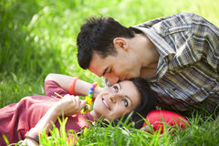 Couple Relaxing on Green grass Stock Image