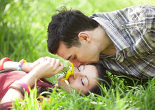 Couple Relaxing on Green grass Royalty Free Stock Photography
