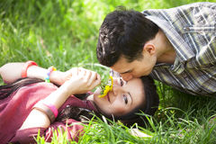 Couple Relaxing on Green grass Royalty Free Stock Image