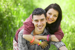 Couple Relaxing on Green Grass Royalty Free Stock Photo