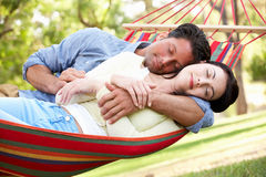 Couple Relaxing In Hammock Stock Photography