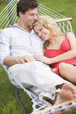 Couple relaxing in hammock smiling Royalty Free Stock Image
