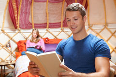 Couple Relaxing On Holiday In Yurt. Couple Relax On Holiday In Yurt royalty free stock photos