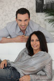 Couple relaxing at home Royalty Free Stock Photos