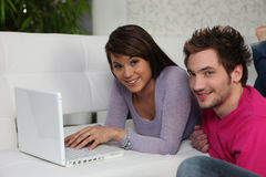 Couple relaxing at home Stock Images