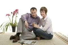 Couple relaxing at home Stock Photos