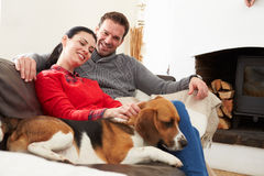 Couple Relaxing At Home With Pet Dog Royalty Free Stock Photo