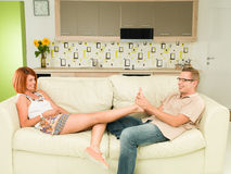 Couple relaxing at home on sofa Stock Photo
