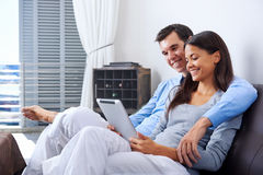Couple reading at home Royalty Free Stock Images