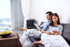 Couple reading at home Stock Images