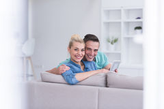 Couple relaxing at  home with tablet computers Royalty Free Stock Photo