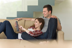 Couple relaxing at  home with tablet computers Royalty Free Stock Photos