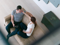 Couple relaxing at  home with tablet computers Stock Images