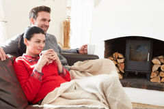 Couple Relaxing At Home Watching Television Royalty Free Stock Photography