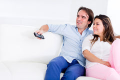 Couple relaxing at home watching tv Stock Photography