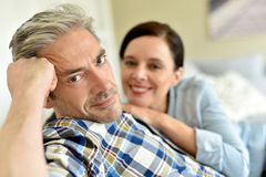 Couple relaxing at home with wife Royalty Free Stock Photos